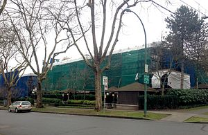 """Leaky condo crisis - Low-rise residential building undergoing repairs to correct apparent """"leaky condo syndrome"""" in Vancouver's West Point Grey neighborhood, 2014."""