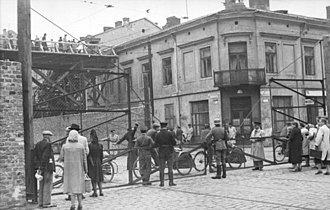 "Warsaw Ghetto Uprising - Corner of Żelazna 70 and Chłodna 23 (looking east). This section of Żelazna street connected the ""large ghetto"" and ""small ghetto"" areas of German-occupied Warsaw."