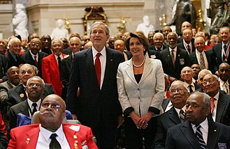 President George W. Bush and Pelosi honoring 300 Tuskegee Airmen at the Capitol, March 2007 Bush and Pelosi at Tuskegee Airmen ceremony.jpg