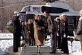 Bush greets Thatcher after landing in helicopter Camp David.jpg