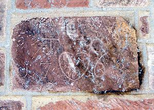 Thomas Cadmus - Datestone carved with Thomas Cadmus' initials, year (1763), and symbols.