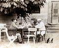 Card game, hat, men Fortepan 100952.jpg