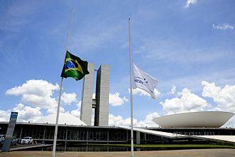 Half-mast - The Brazilian flag, besides the Mercosul flag, flying at half-mast in front of the National Congress of Brazil in memory of the victims of the Chapecoense crash in November 29, 2016.
