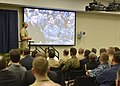 Chief of U.S. Naval Operations Adm. Jonathan Greenert, standing, speaks during an all-hands call at U.S. Fleet Cyber Command-U 131217-N-ZI511-811.jpg