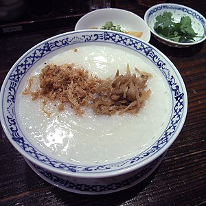 A typical rice porridge complete with dried mi...