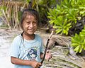 Chistmas Island girl with stick - Kiritimati (14173486718).jpg