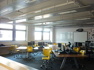 Thermal mass - A modern school classroom with natural ventilation by opening windows and exposed thermal mass from a solid concrete floor soffit to help control summertime temperatures