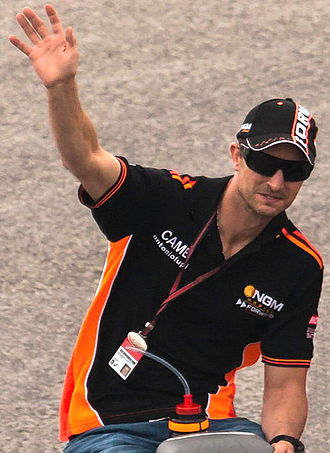 Colin Edwards - Edwards wearing NGM colours waving to spectators from an open-top car at the 2014 Motorcycle Grand Prix of the Americas.