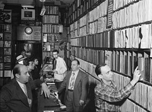Commodore Records - Milt Gabler, Herbie Hill, Lou Blum and Jack Crystal at the Commodore Music Shop, New York City (1947)