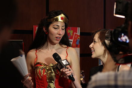 Journalists interviewing a cosplayer Cosplayers at Comicdom 2012 in Athens, Greece grant interviews to the MTV television channel 21.JPG