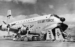 63d Operations Group - 63d TCG C-124 at Hamilton AFB, California being prepared to load a Lockheed F-104 Starfighter being transported to Formosa, 1958