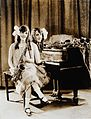 Daisy and Violet Hilton, conjoined twins, with piano and sax Wellcome V0029580.jpg
