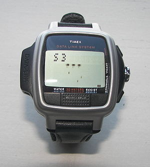 Wearable computer - Timex Datalink USB Dress edition with Invasion video game. The watch crown (icontrol) can be used to move the defender left to right and the fire control is the Start/Split button on the lower side of the face of the watch at 6 o' clock.