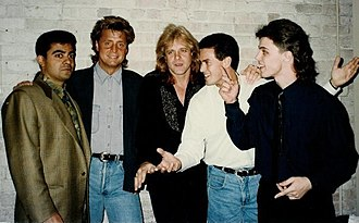 Eddie Money - Money, center, in 1990