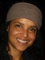 A women with black hair, wearing a brown hat.