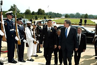 Vajiralongkorn - US Deputy Secretary of Defense Paul Wolfowitz (right) escorts Crown Prince Maha Vajiralongkorn through an honor cordon and into the Pentagon on 12 June 2003.