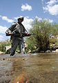 Defense.gov News Photo 100621-A-1619C-424 - U.S. Army Spc. Brandon Rodriguez crosses a stream while patrolling the area surrounding Forward Operating Base Baylough in Zabul province.jpg