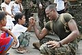 Defense.gov News Photo 101014-M-2755L-073 - A U.S. Navy sailor right entertains children at Calumpang Elementary School in Mabalacat Pampanga Philippines after completing volunteer work as.jpg
