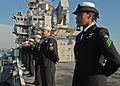 Defense.gov News Photo 101118-N-5537T-013 - Sailors man the rails aboard the multi-purpose amphibious assault ship USS Iwo Jima LHD 7 as they return to Norfolk after a four-month Continuing.jpg