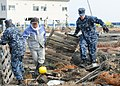 Defense.gov News Photo 110314-N-MU720-059 - Chief Petty Officer Kyle Wilkinson right from Baldwinsville N.Y. assigned to Naval Air Facility Misawa helps remove debris during a cleanup.jpg