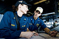 Defense.gov News Photo 110412-N-6320L-085 - Cmdr. Christopher Valdivia auxiliaries officer aboard the aircraft carrier USS Carl Vinson CVN 70 explains how to plot the ship s coordinates to.jpg
