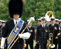 The U.S. Navy Band shown at ease; Drum-Major in front.