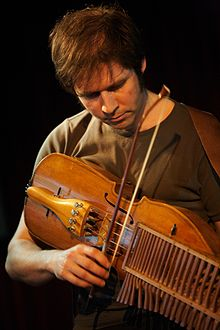 Didier François playing the Nyckelharpa