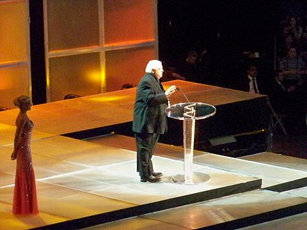 Rhodes at the 2009 WWE Hall of Fame ceremony, inducting the Funk Brothers Dusty Rhodes.jpg