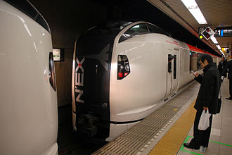 Narita Express - Two E259 series trainsets dividing at Tokyo Station, February 2011