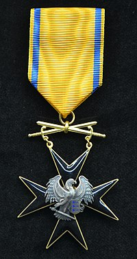 EST Order of the Cross of the Eagle 5th class with swords badge.jpg