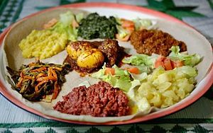 Eritrean cuisine - A plate of Injera with various Eritrean stews