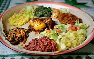 Eritrean injera with various stews Eritrean Injera with stews.jpg