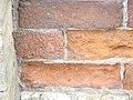 Eroded bricks sw corner of front and frederick, 2013 02 18 -bi.JPG - panoramio.jpg