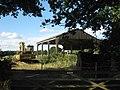 Excavator and Dutch Barn, Waterman Lane - geograph.org.uk - 1389496.jpg