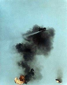 F-14A flies over QF-86F debris 1977.jpeg