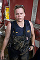 FEMA - 39068 - Local fire figher helping with clean up in Puerto Rico.jpg
