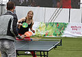 Fans try out table tennis at the Russia House (7741303724).jpg