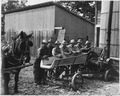Farm Security Administration, Seven of eight farmers shown with their cooperativelyowned ensillage cutter on the... - NARA - 195847.tif