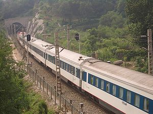Beijing–Guangzhou Railway - A train from Beijing to Guangzhou entering the Huaishuling Tunnel in Fengtai District, Beijing.