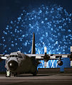 Fireworks explode behind a C-130 Hercules at Yokota Air Base, Japan (1).jpg