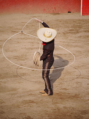 Trick roping - A charro demonstrating trick roping, circa 2013
