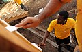 Flickr - Official U.S. Navy Imagery - Sailors paint a hut in Honduras as part of community service project..jpg