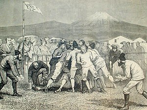 Japan Rugby Football Union - Rugby game in Yokohama, 1874 with interested locals and Mount Fuji in the background