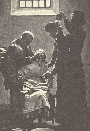 English: A suffragette on a hunger strike bein...