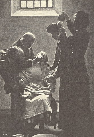 Force-feeding - A suffragette is force-fed in HM Prison Holloway in the UK during hunger strikes for women's suffrage.