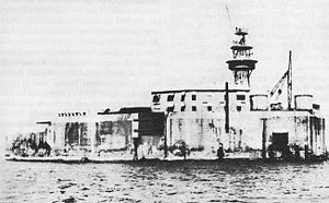 """14-inch gun M1907 - Fort Drum in Manila Bay, called the """"concrete battleship"""", was a unique fort mounting four 14-inch guns in two twin turrets."""
