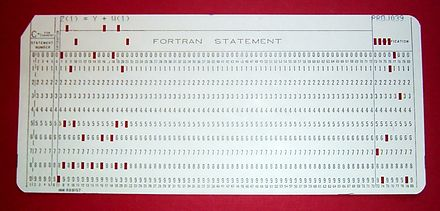 "A 1970s punched card containing one line from a Fortran program. The card reads: ""Z(1) = Y + W(1)"" and is labeled ""PROJ039"" for identification purposes. FortranCardPROJ039.agr.jpg"