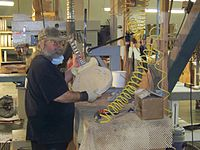 GMFT6-3 craftsman with semi-hollow guitar in work in process.jpg