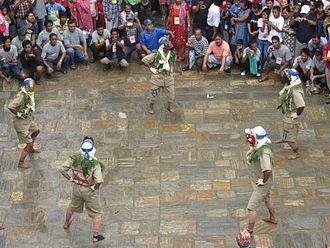 Gai Jatra - People dressed as different deities dancing in procession of Gai Jatra.