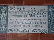 A tablet formed of six standard sized tiles, bordered by green flowers in the style of the Arts and Crafts movement
